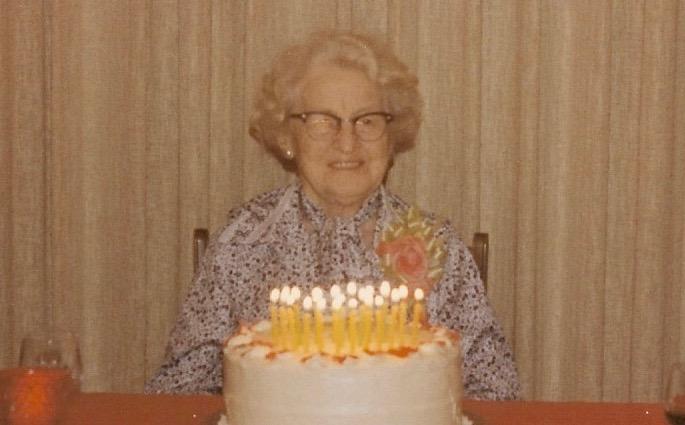 Raye Green in front of birthday cake